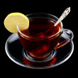 Cup of tea with spoon and lemon — Stock Photo