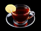 Glass cup of tea with lemon isolated — Stock Photo
