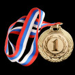 Gold medal isolated on black — Stock Photo