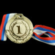 Gold medal isolated on black - Stock Photo