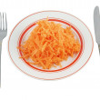 Fresh grated carrot with fork and knife — Stock Photo