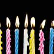 Seven candles on black background — Stock Photo