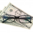 Black modern spectacles and dollars — Stock Photo