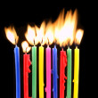 Melting candles on black background — Stock Photo