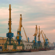Cranes in the evening river port — Stock Photo