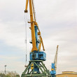 Big crane in the city river port - Stock Photo