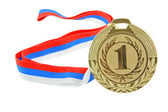 Gold medal isolated on white — Stock Photo