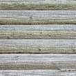 Texture of burnt wooden house wall — Stock Photo #1574574
