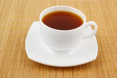 White cup of tea on wooden background — Stock Photo