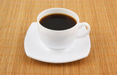 Cup of coffee on wooden background — Stock Photo
