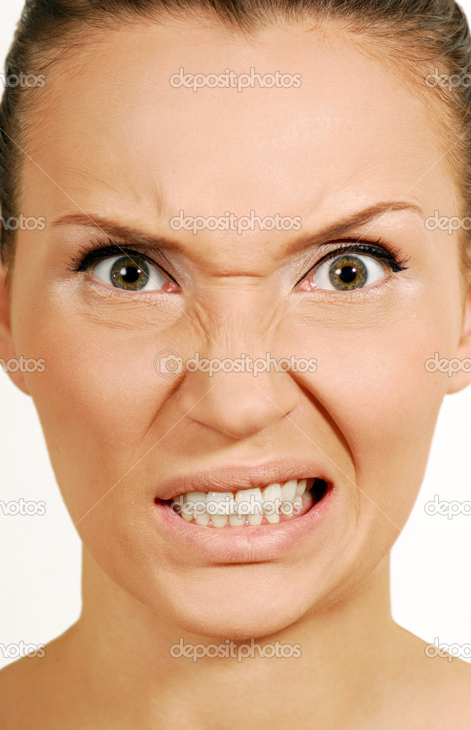 Woman's Face  with a grimace of spite, anger. Natural makeup. Close-up face. — Stock Photo #1459972