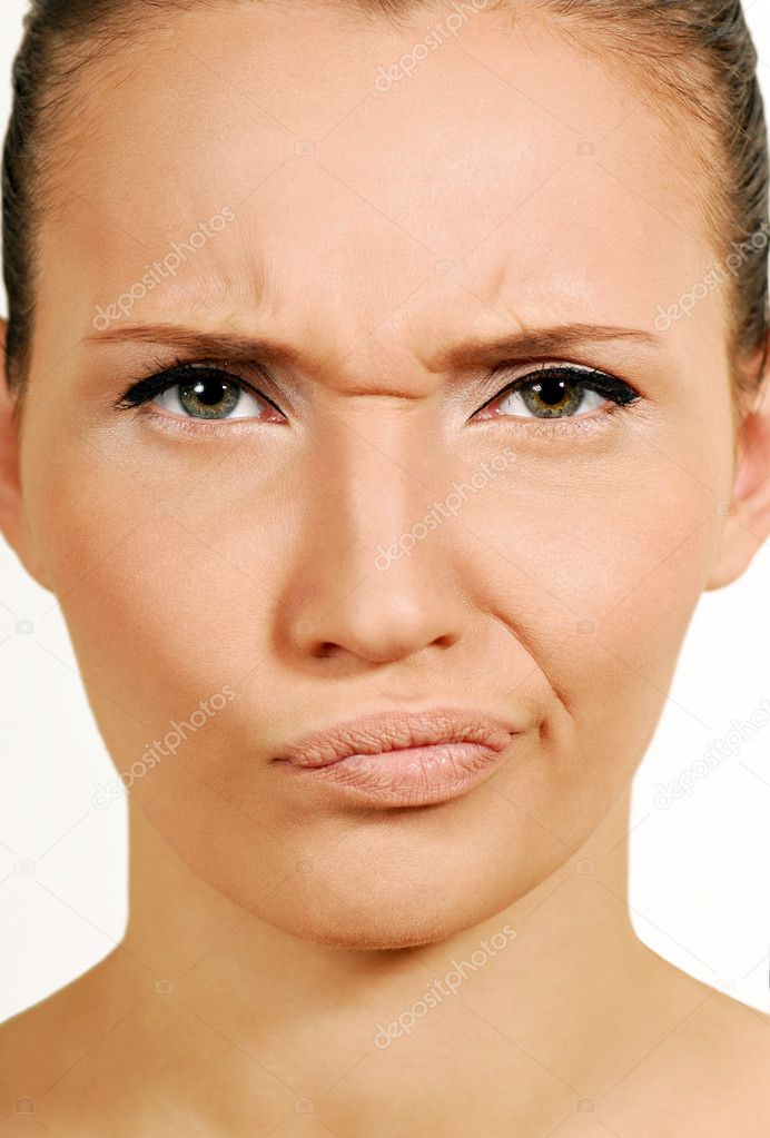 Woman's Face  with a grimace of Distrust, Jealousy. Natural makeup. Close-up face. — Stock Photo #1459980