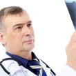 Mature male doctor looking on the X-ray — Stock Photo