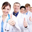 Medical doctors giving thumbs-up - Stok fotoğraf