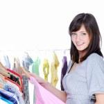 Happy woman choosing clothing — Stock Photo