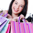 Laughing young woman shooping with  bags - Stock Photo