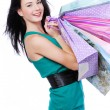 Beautiful young woman with purchases — Stock Photo #1463519