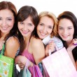 图库照片: Happy smiling girls with shopping bag