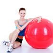 Pretty girl with red fitball — Stock Photo #1467553