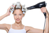Woman hair-curles hairdryer hairs — Stock Photo