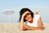 Happy beautiful woman on beach — Stock Photo