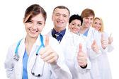 медицинские врачи, давая пальцы — Стоковое фото
