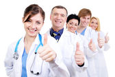 Medical doctors giving thumbs-up — Stok fotoğraf