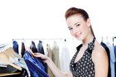 Beautiful woman choose clothes — Stock Photo