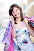 Beautiful femlae holding bags — Stock Photo