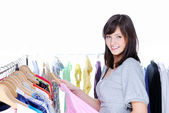 Happy woman choosing clothing — Stok fotoğraf