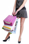Unrecognizable female holding shopping — Stock Photo
