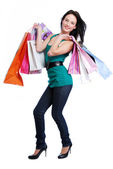 Young pretty woman with purchase — Stock Photo