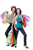 Two happy beautiful women purchases — Stock Photo