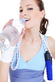 Girl drinking water after train — Stock Photo
