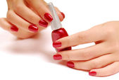 Red bottle of nail polish — Stock Photo
