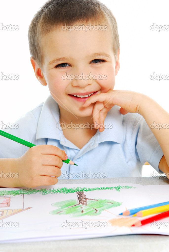 Cute preschooler boy draw using the green crayon — Stock Photo #1460265