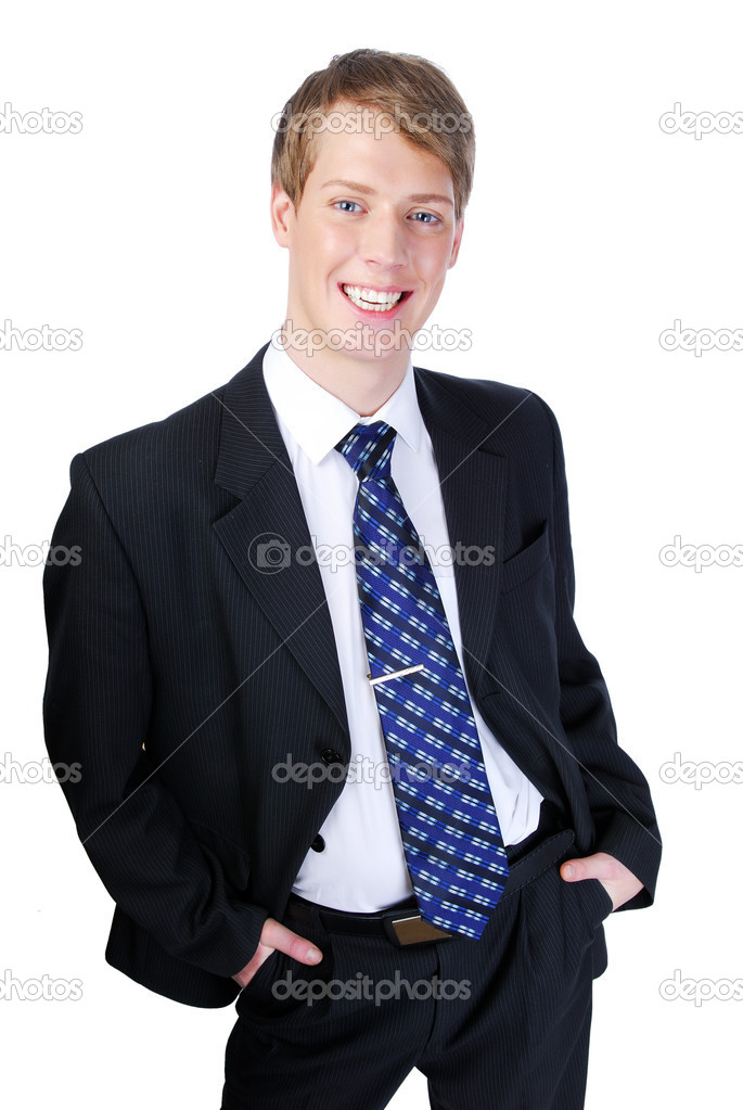 Cheerful young man in black suit with hands in pocket - isolated on white — Stock Photo #1460763