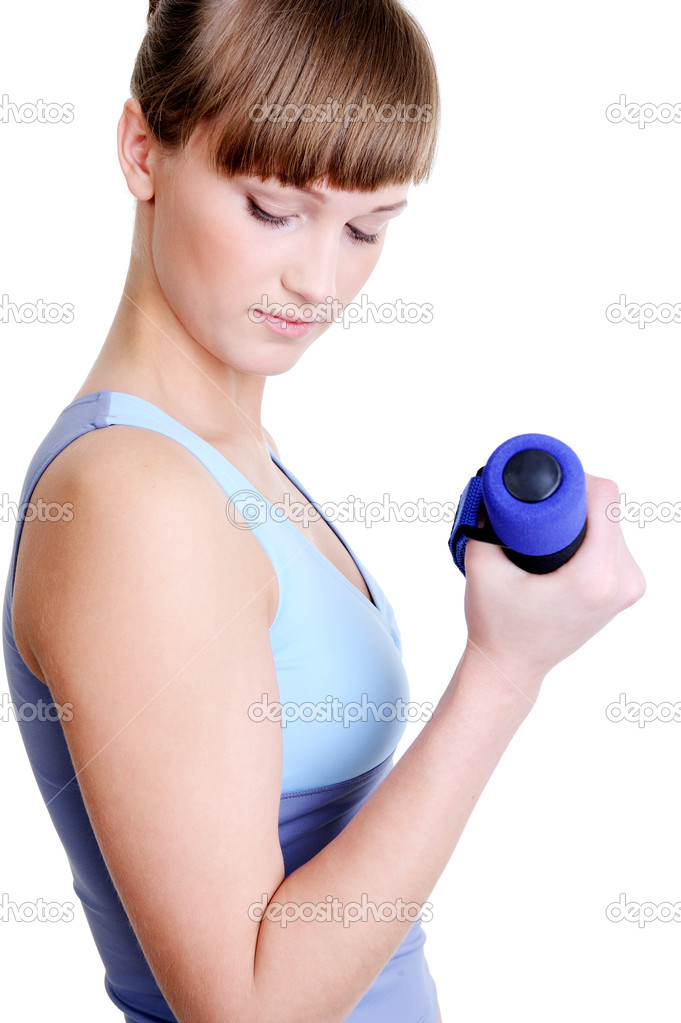 Young beautiful girl bending arm with dumbbell - white background  Stock Photo #1461056