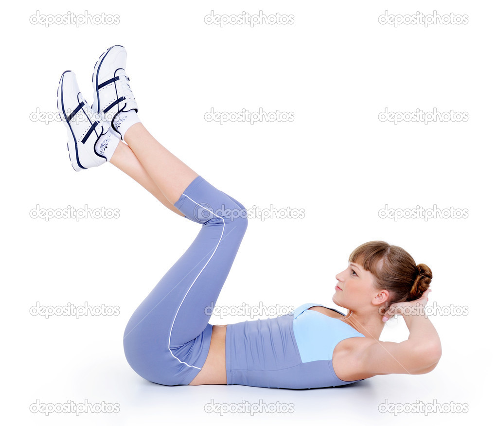 Beautiful young woman lying on the floor and doing physical exercise — Stock Photo #1461077
