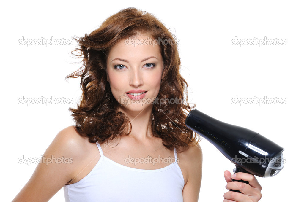 Portrait of beautiful young woman with fashion hairstyle holding hairdryer — Stock Photo #1461886