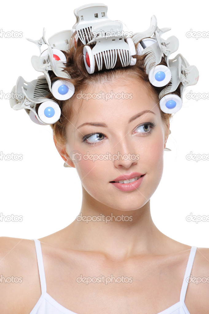 Portrait of beautiful young smiling female with curlers - close-up — Stock Photo #1461888