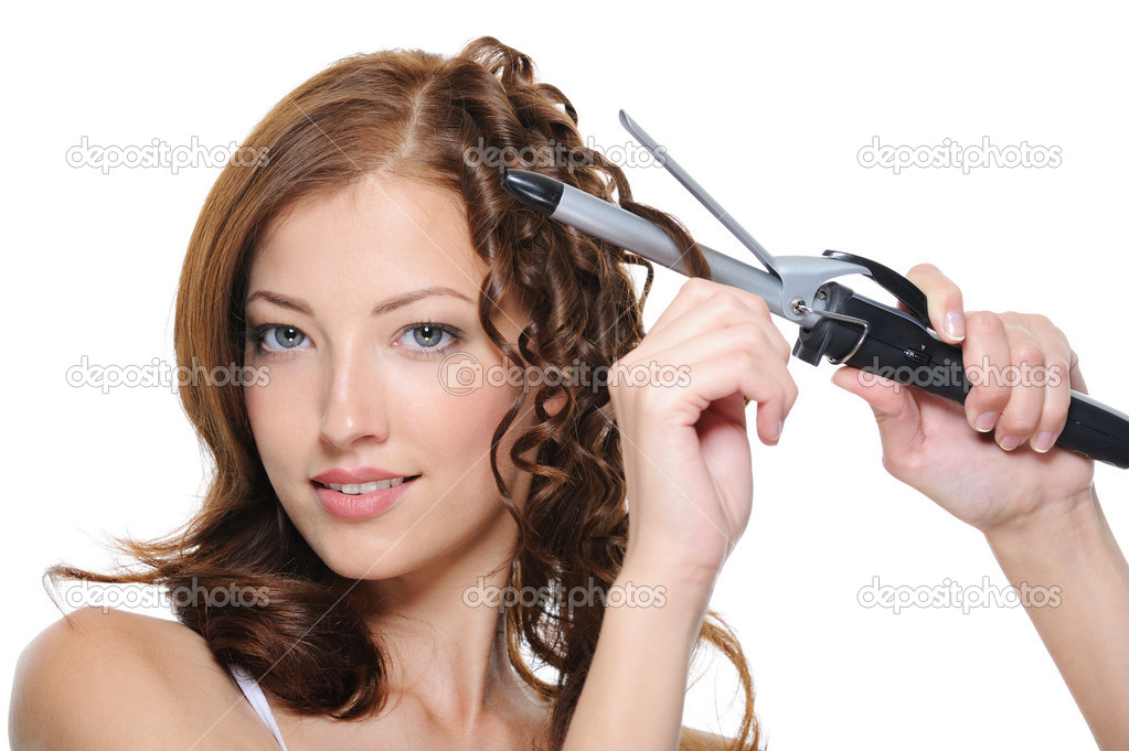 Curling female brunette hair with roller - beautiful woman portrait — Stock Photo #1461891