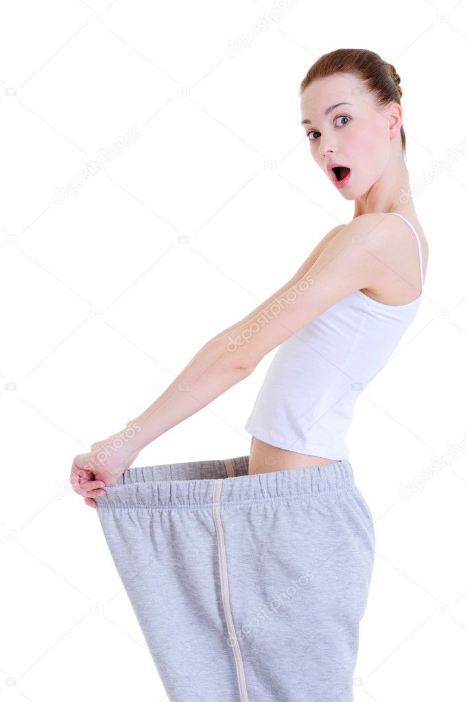 Slender young girl surprised of losing overweight - studio — Stock Photo #1462158