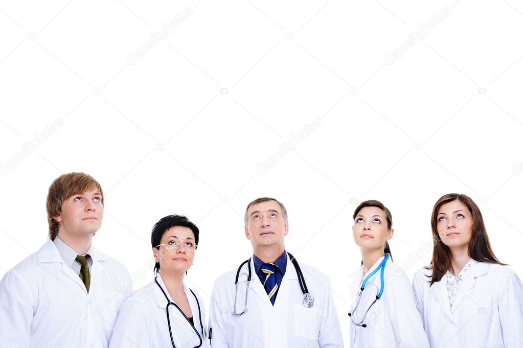 Several doctors in hospital gown looking up - isolated on white background with copy space — Stock Photo #1462712
