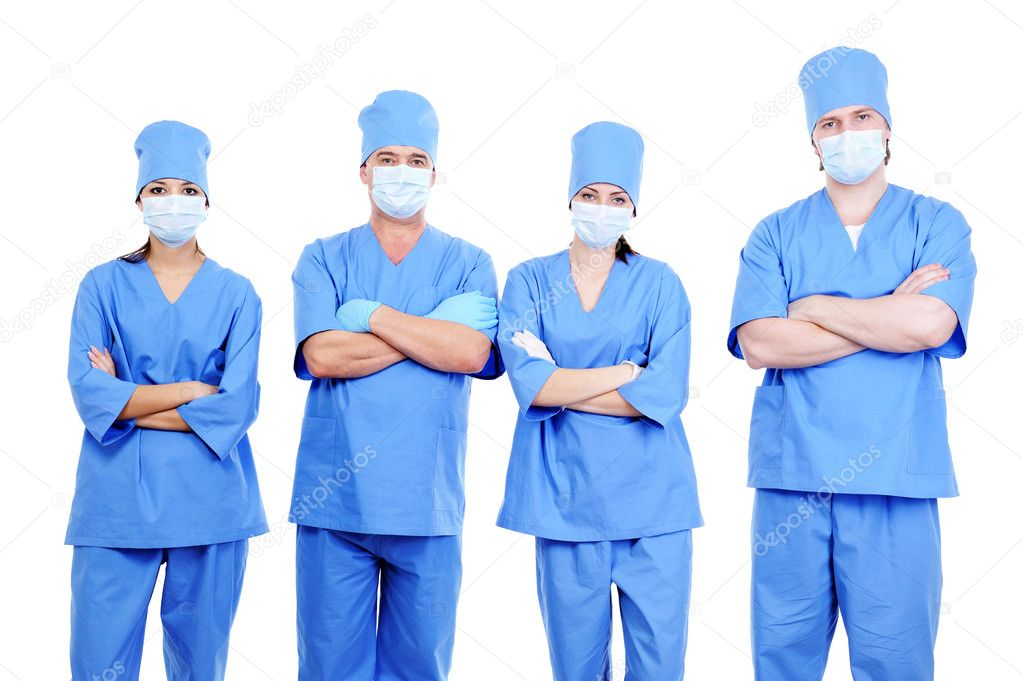 Team of  four surgeons in blue uniform standing together  — Stock Photo #1462770