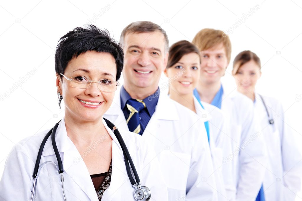 Mature female doctor with group of happy successsful colleagues — Stock Photo #1462781