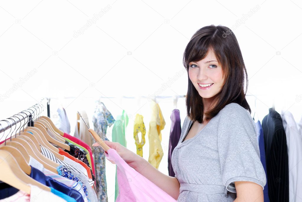 Happy smiling young woman choosing clothing - White background  Stock Photo #1463386