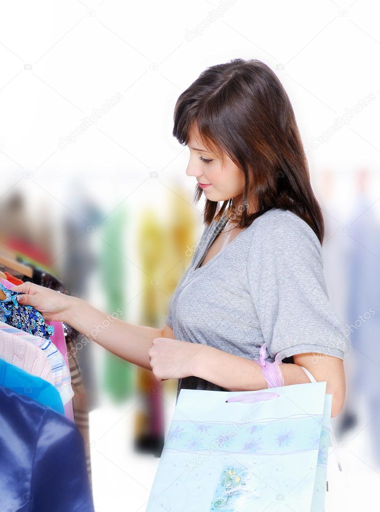 Happy young woman choosing the dress — Stock Photo #1463395