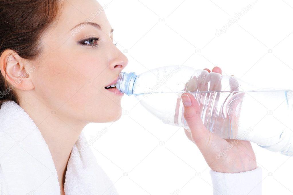 profile portrait of young woman drinking water from bottle — Стоковая фотография #1463784