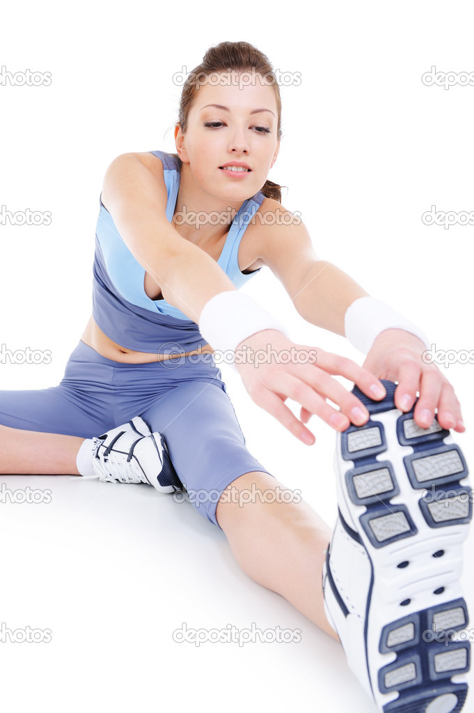 Physical stretching of young sporting attractive girl - isolated    #1463801